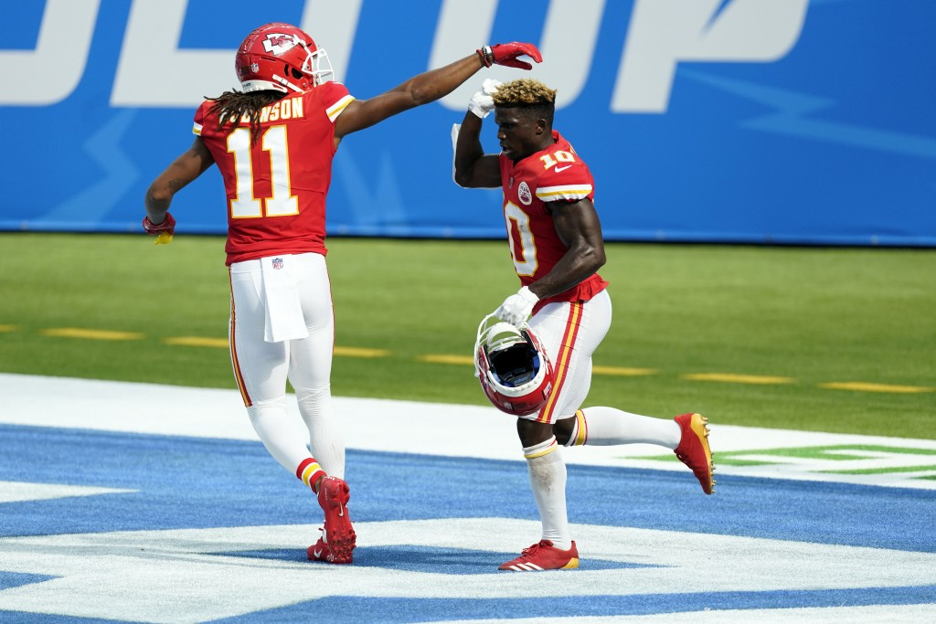 Kansas City Chiefs wide receiver Tyreek Hill, right, celebrates his touchdown catch with wide receiver Demarcus Robinson (11) during the second half o...
