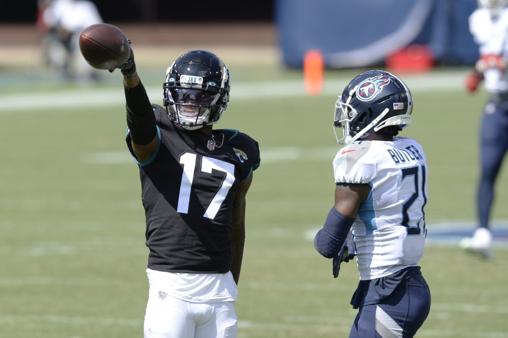 Jacksonville Jaguars wide receiver D.J. Chark (17) signals a first down after a reception against Tennessee Titans cornerback Malcolm Butler (21) in t...