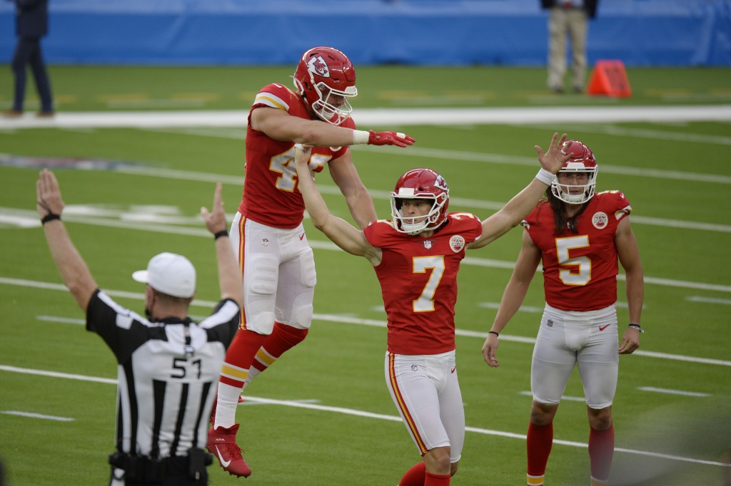 Kansas City Chiefs kicker Harrison Butker (7) celebrates after making the game-winning field goal during overtime of an NFL football game against the ...