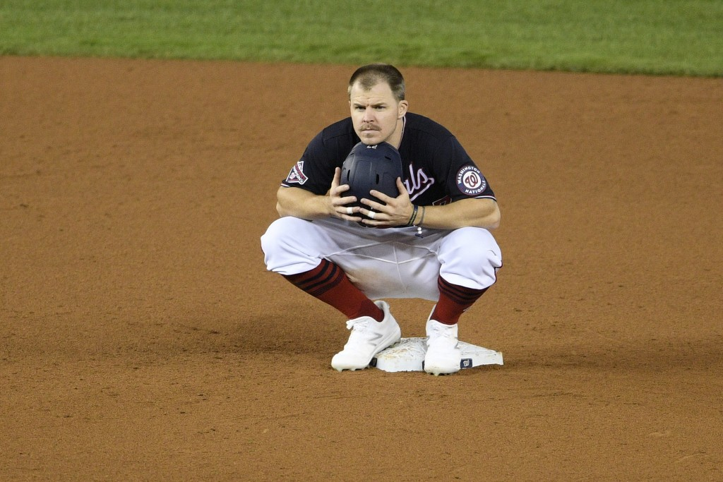 Washington Nationals' Brock Holt crouches at second during a pitching change during the seventh inning of a baseball game against the Philadelphia Phi...