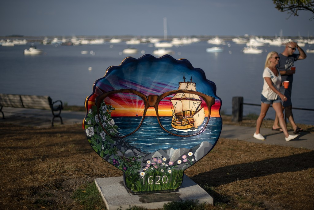 Pedestrians walk past a commemorative shell decorated to celebrate the 400th anniversary of the arrival of the Pilgrims in 1620 on the Mayflower, in P...