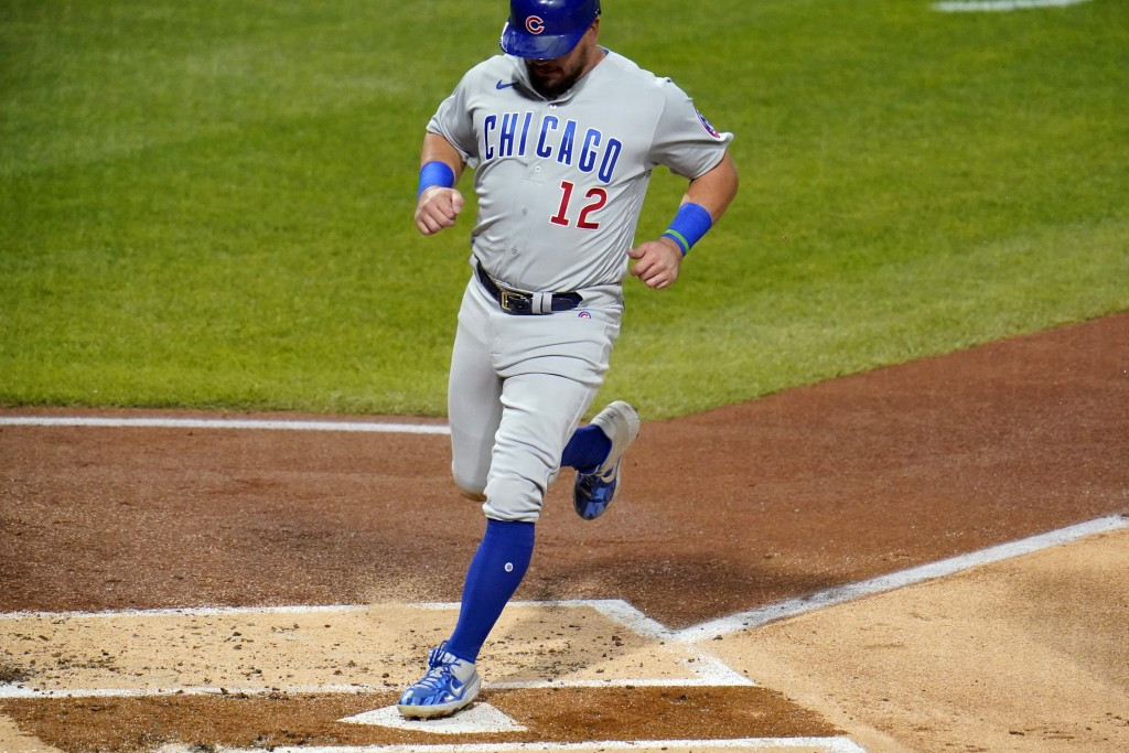 Chicago Cubs' Kyle Schwarber scores from third on a bunt single by Javier Baez during the second inning of a baseball game against the Pittsburgh Pira...