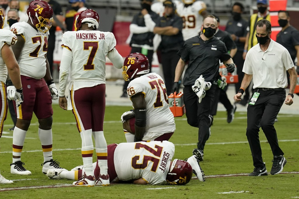 Washington Football Team offensive guard Brandon Scherff (75) lies on the turf after an injury against the Arizona Cardinals during the first half of ...