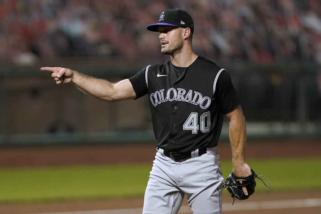 Colorado Rockies relief pitcher Tyler Kinley (40) points to catcher Elias Diaz after the final out of the ninth inning in a baseball game against the ...