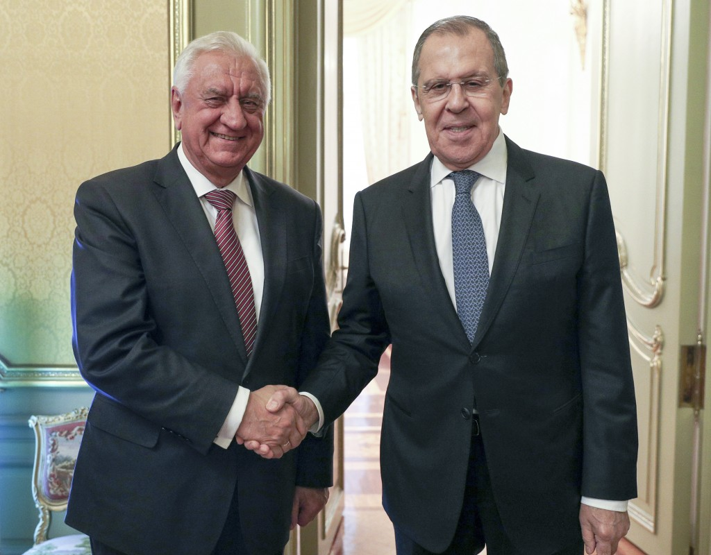 In this photo released by the Russian Foreign Ministry Press Service, Russian Foreign Minister Sergey Lavrov, right, and Chairman of the Board of the ...