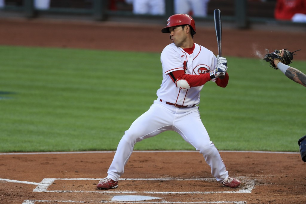 Cincinnati Reds' Shogo Akiyama reacts to a pitch as he bats in the first inning during a baseball game against the Milwaukee Brewers in Cincinnati, Mo...