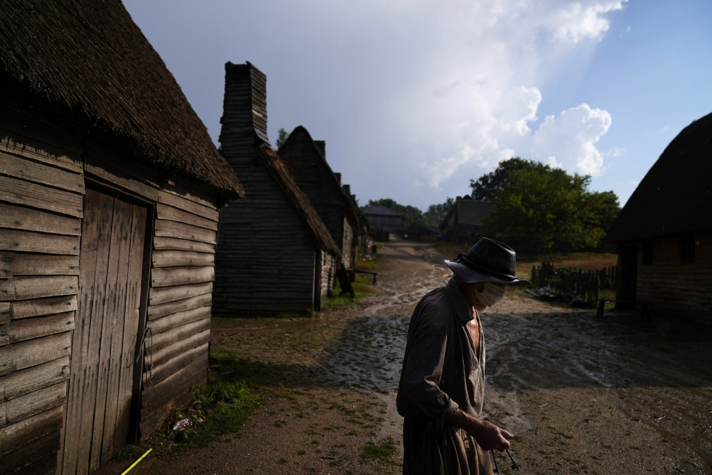 Museum educator Scott Atwood, playing the role of Pilgrim Stephen Hopkins, walks through Plimoth Plantation, a living history museum village, after lo...