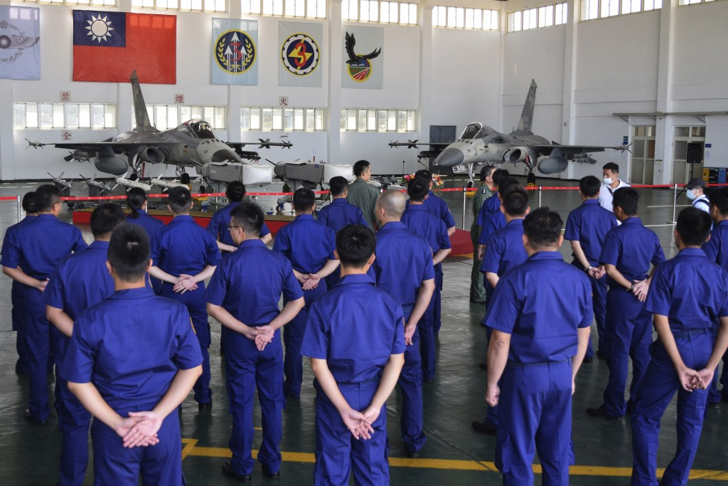 Taiwanese airmen gather during a visit by Taiwan President Tsai Ing-wen to the Penghu Magong military air base in outlying Penghu Island, Taiwan Tuesd...