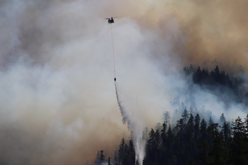 In this Sept. 3, 2020, photo provided by the Opal Creek Ancient Forest Center, fire retardant is dropped at Jawbone Flats in the Opal Creek Wilderness...