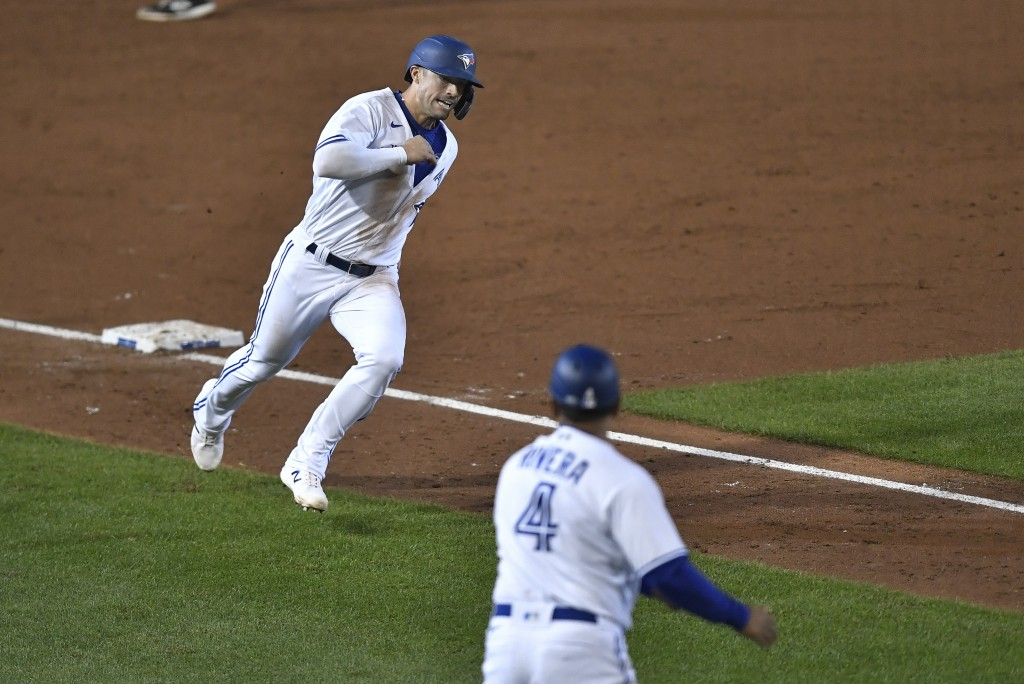 Toronto Blue Jays' Randal Grichuk, left, rounds third to score against the New York Yankees on a double hit by Vladimir Guerrero Jr. during the third ...