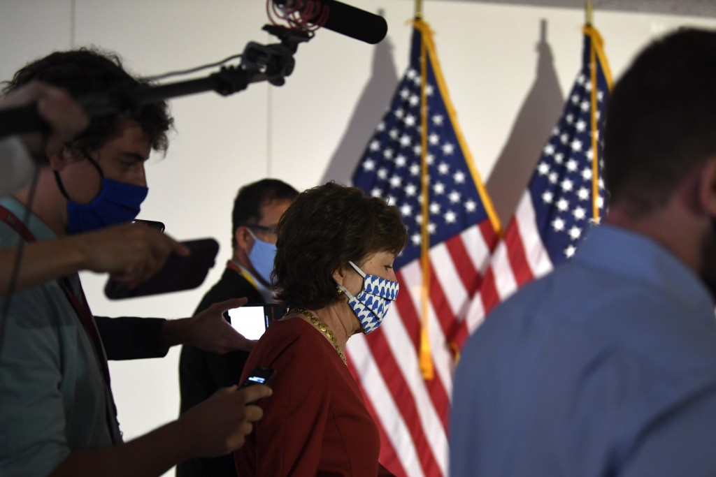 FILE - In this June 9, 2020, file photo Sen. Susan Collins, R-Maine, is followed by reporters as she arrives for the weekly Republican policy luncheon...