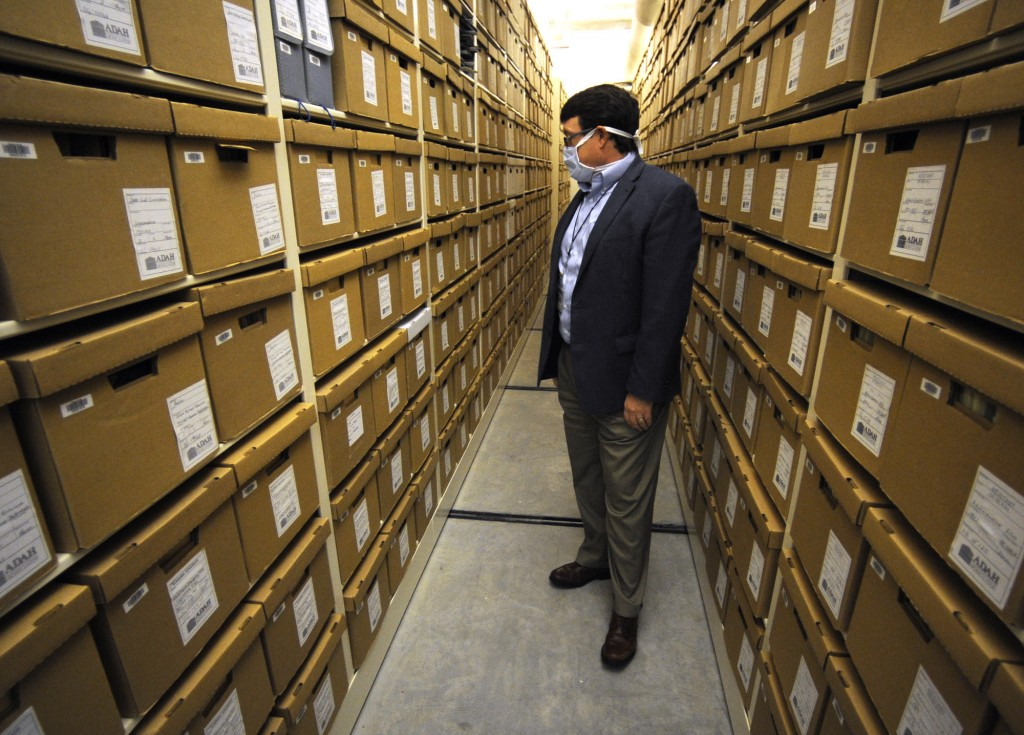 Steve Murray, director of the Alabama Department of Archives and History, looks through boxes containing archival materials in Montgomery, Ala., on Th...
