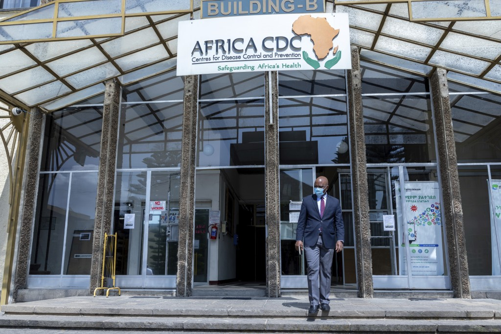 John Nkengasong, director of the Africa Centers for Disease Control and Prevention, walks outside the organization's headquarters in Addis Ababa, Ethi...