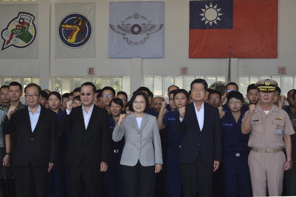 Taiwan President Tsai Ing-wen, center, poses for photos at the Penghu Magong military air base in outlying Penghu Island, Taiwan Tuesday, Sept. 22, 20...