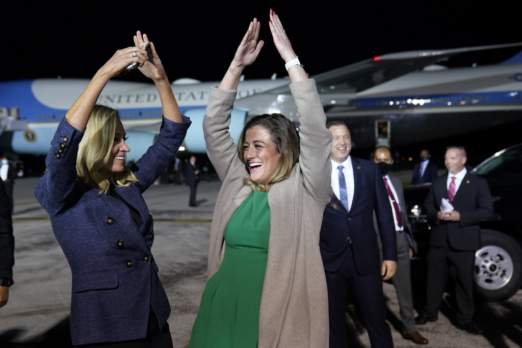 White House press secretary Kayleigh McEnany and White House legislative aide Cassidy Hutchinson dance to the song YMCA as President Donald Trump ends...
