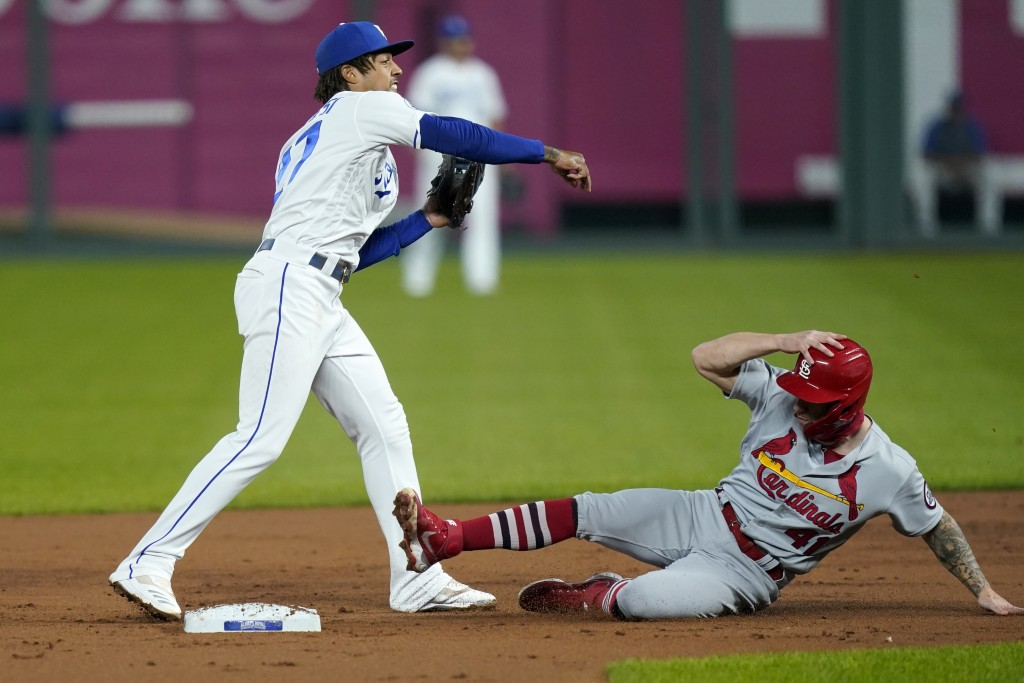 Kansas City Royals shortstop Adalberto Mondesi, left, forces out St. Louis Cardinals Tyler O'Neill (41) during the second inning of a baseball game in...