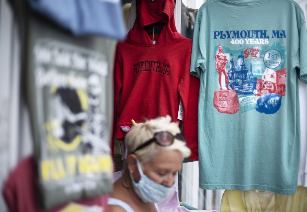 A pedestrian walks past a gift shop in Plymouth, Mass., the traditional point of arrival of the Pilgrims in 1620 on the Mayflower, Wednesday, Aug. 12,...