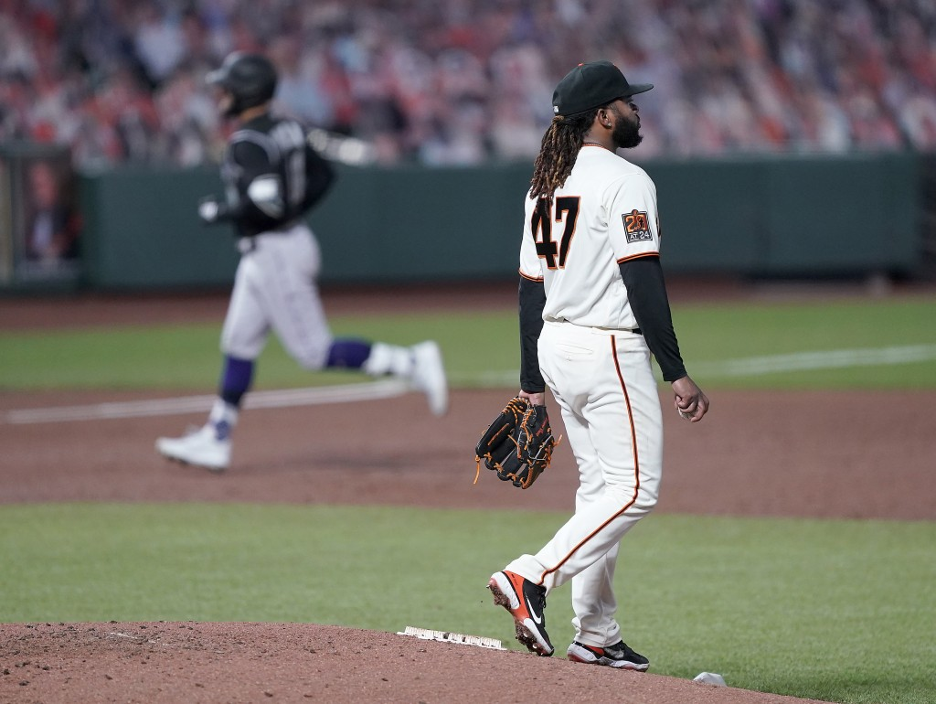 San Francisco Giants starting pitcher Johnny Cueto (47) stands on the mound as Colorado Rockies' Kevin Pillar, left, rounds the bases after hitting a ...