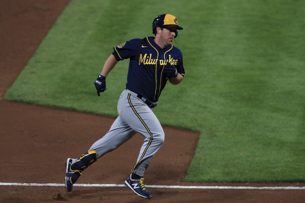 Milwaukee Brewers' Jedd Gyorko runs the bases after hitting a solo home run in the fifth inning during a baseball game against the Cincinnati Reds in ...