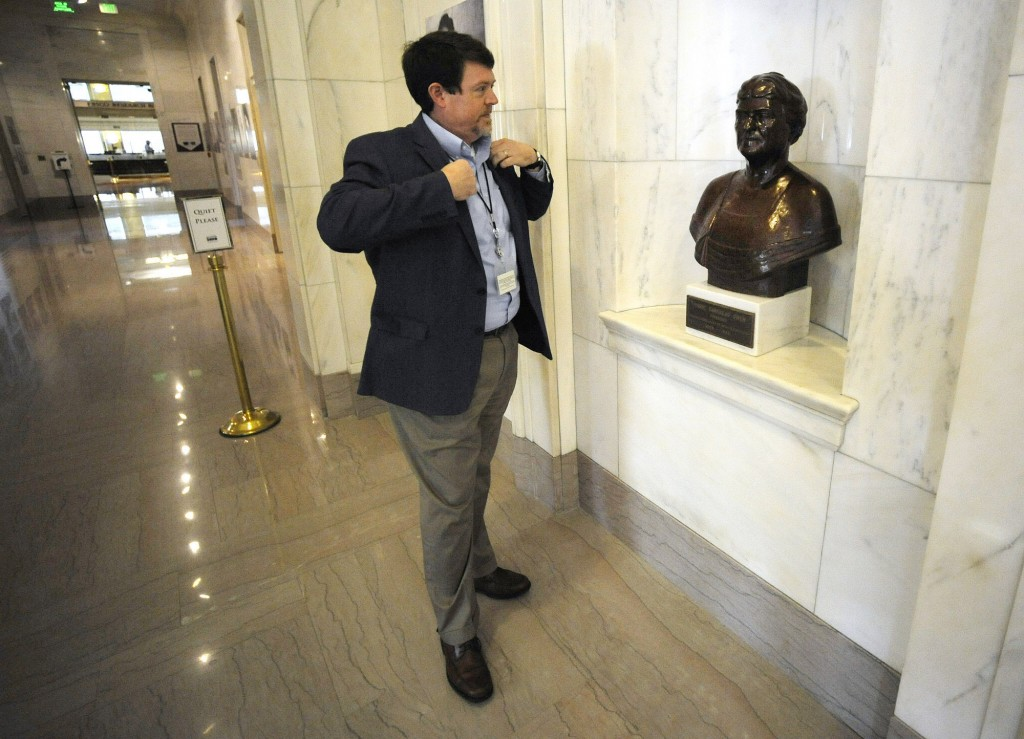 Steve Murray, director of the Alabama Department of Archives and History, pauses by a bust of former director Marie Bankhead Owen in Montgomery, Ala.,...