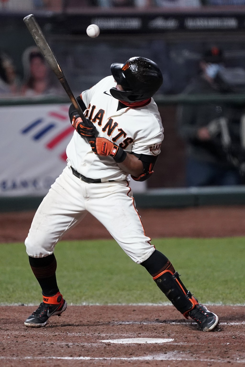 San Francisco Giants' Donovan Solano is hit by a pitch against the Colorado Rockies during the seventh inning of a baseball game on Monday, Sept. 21, ...