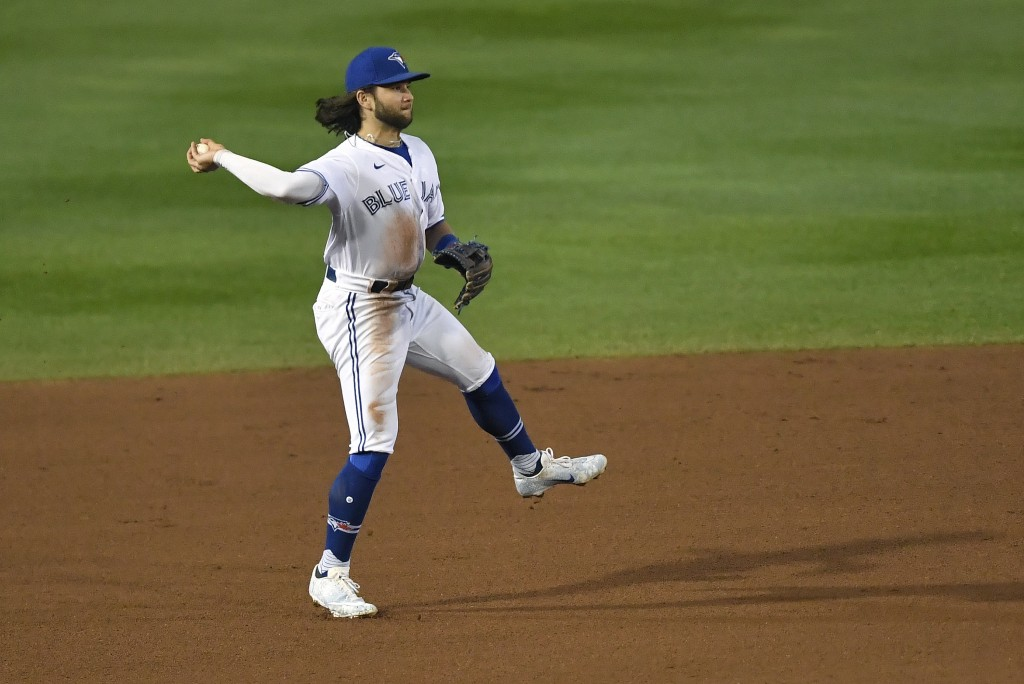 Toronto Blue Jays shortstop Bo Bichette fields a ground ball by New York Yankees' Gio Urshela who was out at first during the fourth inning of a baseb...