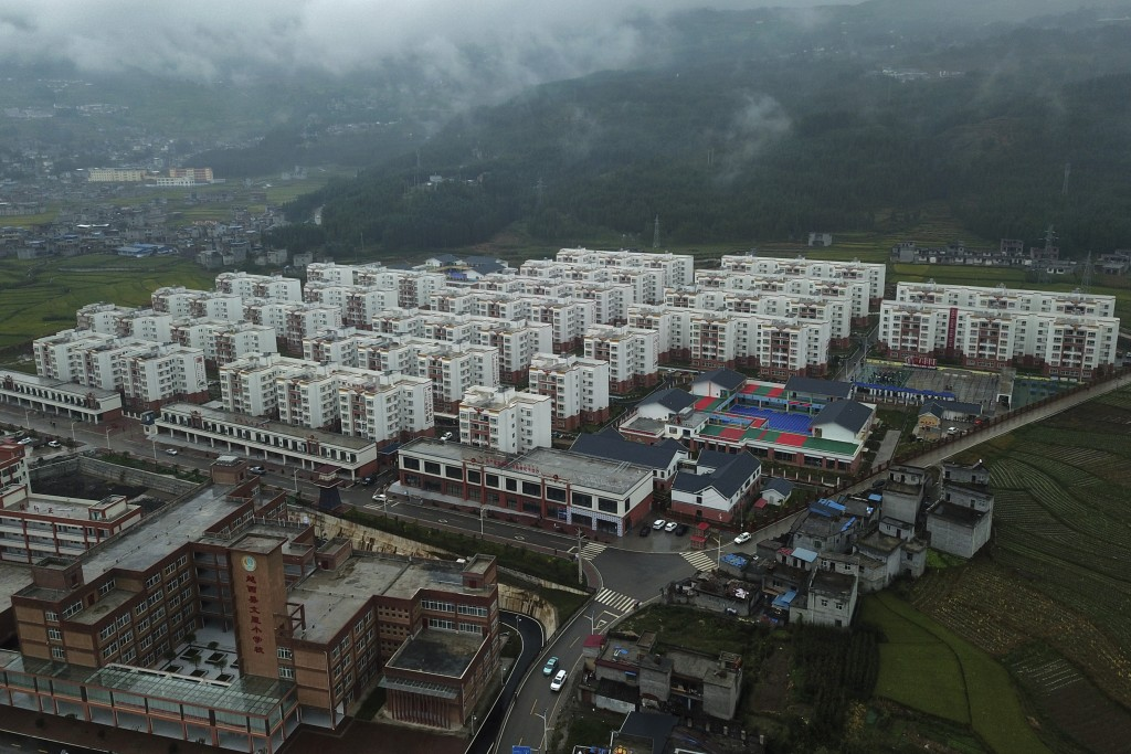 An aerial view shows apartments built by the Chinese government for ethnic minority in Yuexi county, southwest China's Sichuan province on Sept. 11, 2...