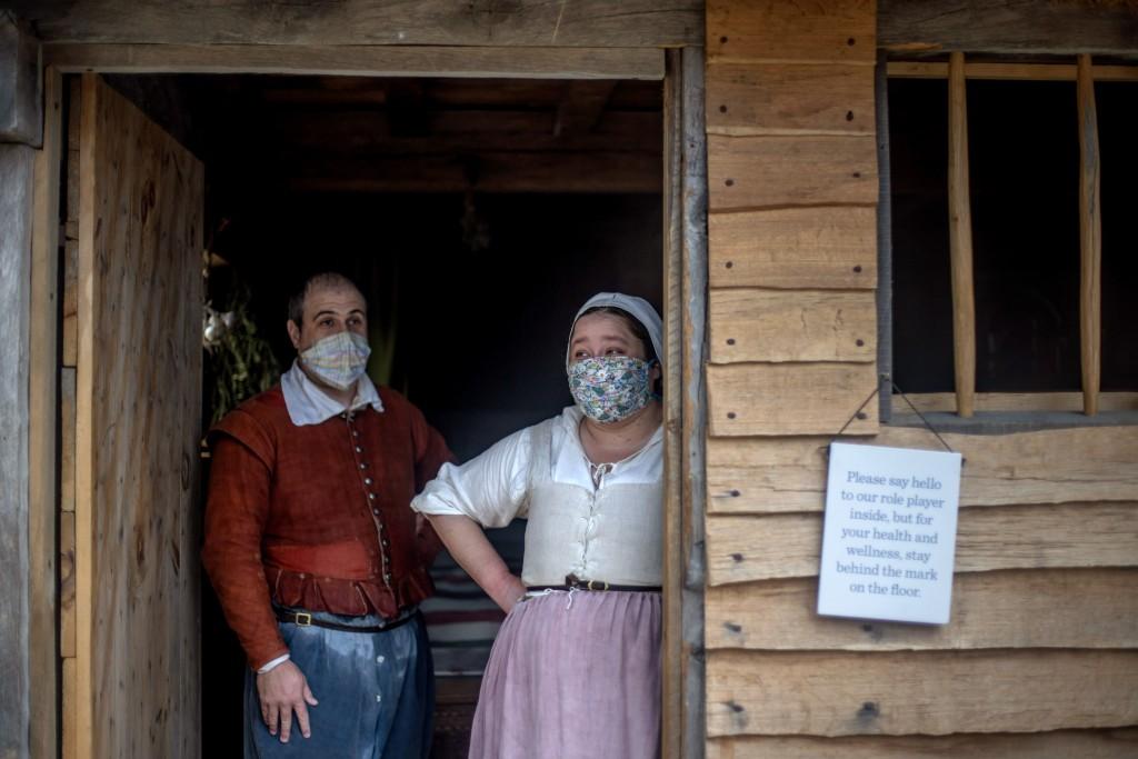Museum educators Doug Blake, left, and Alexandra Cervenak, playing the roles of Pilgrims William and Alice Bradford, wait for visitors at Plimoth Plan...