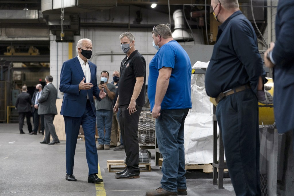 Democratic presidential candidate former Vice President Joe Biden tours the Wisconsin Aluminum Foundry in Manitowoc, Wis., Monday, Sept. 21, 2020. (AP...