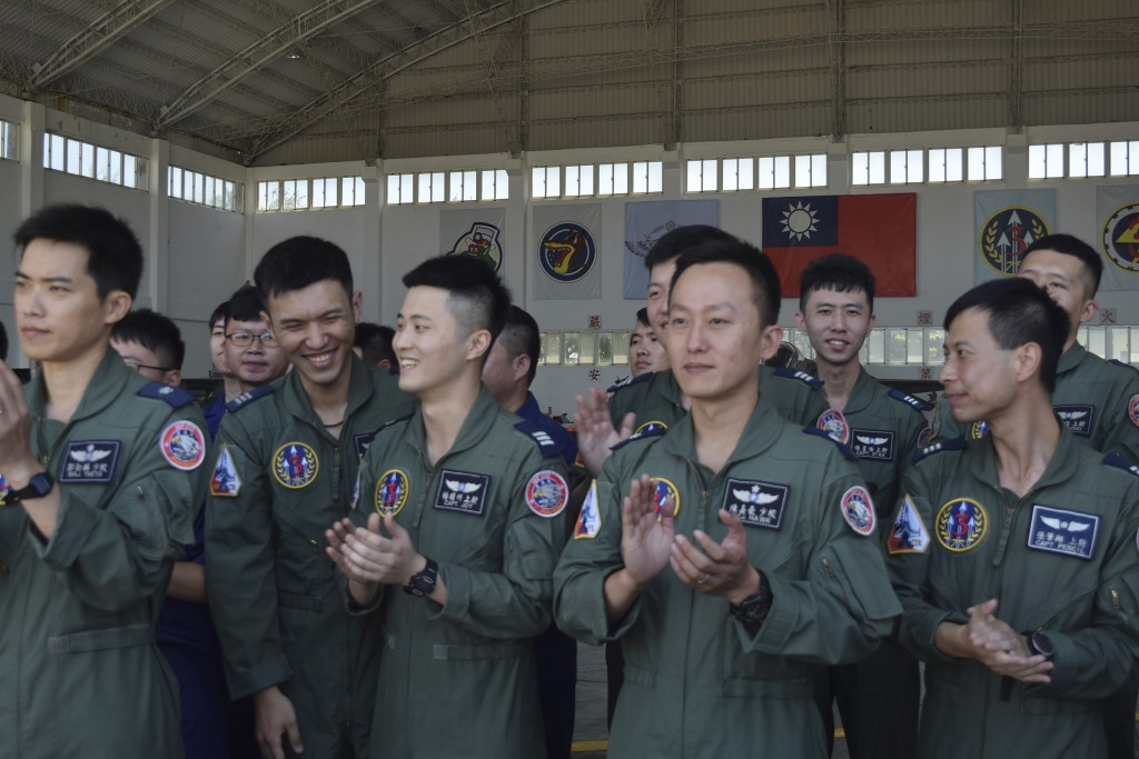 Taiwanese airmen applaud as they listen to Taiwan President Tsai Ing-wen speak during her visit to the Penghu Magong military air base in outlying Pen...