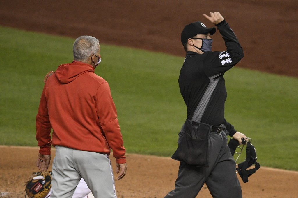 Home plate umpire Junior Valentine, right, ejects Philadelphia Phillies manager Joe Girardi, left, during the third inning of a baseball game against ...
