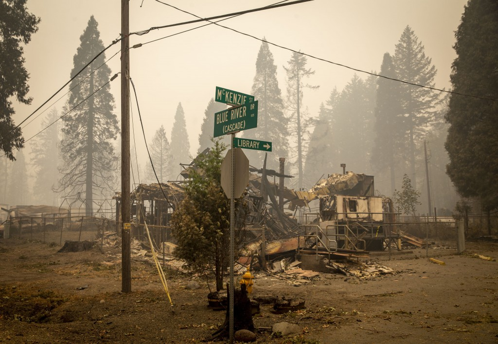 FILE - In this Sept. 15, 2020, file photo, scorched property stands at an intersection in Blue River, Ore., days after a blaze known as the Holiday Fa...