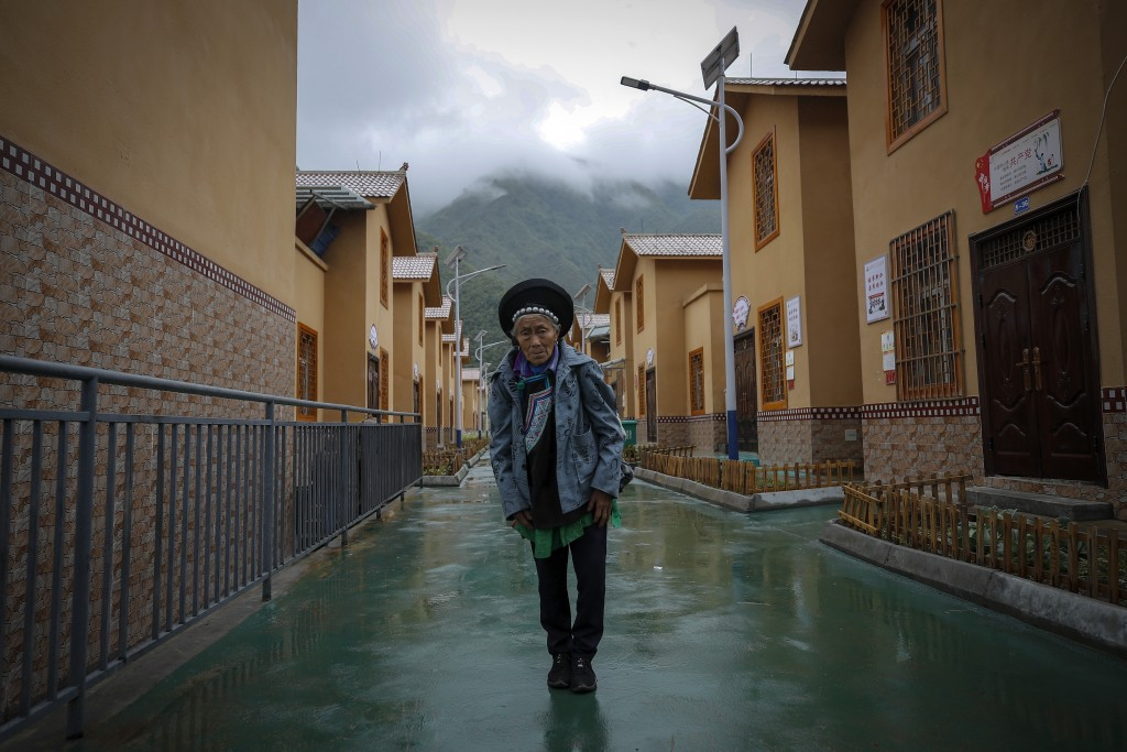 A minority woman stands in between new village houses in Ganluo county, southwest China's Sichuan province on Sept. 10, 2020. China's  ruling Communis...