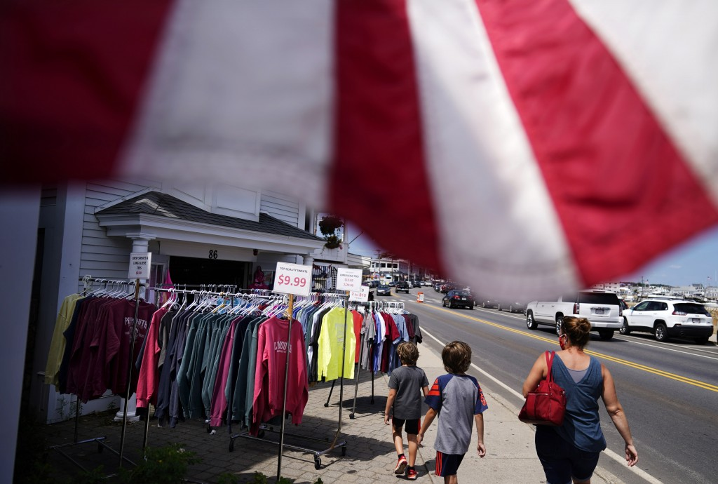 Pedestrians walk past a gift shop in Plymouth, Mass., the traditional point of arrival of the Pilgrims in 1620 on the Mayflower, Wednesday, Aug. 12, 2...