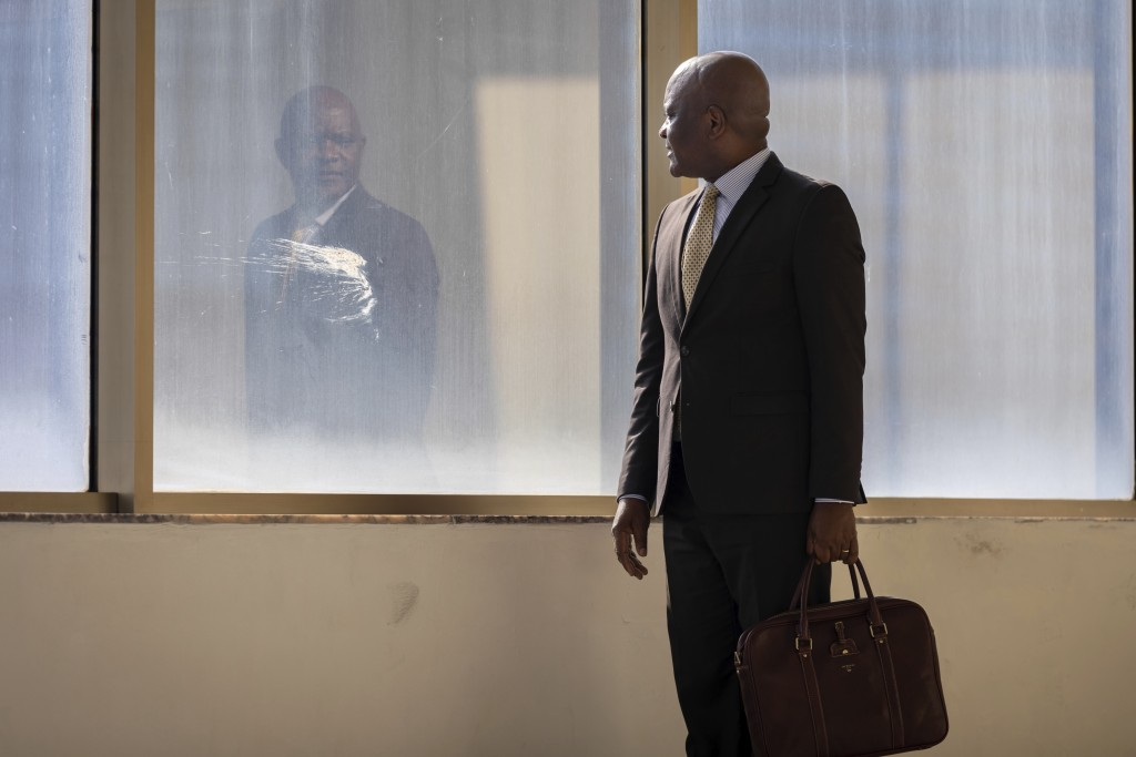 John Nkengasong, director of the Africa Centers for Disease Control and Prevention, walks in the organization's headquarters in Addis Ababa, Ethiopia ...