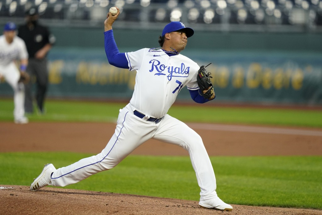 Kansas City Royals starting pitcher Carlos Hernandez delivers to a St. Louis Cardinals batter during the first inning of a baseball game at Kauffman S...