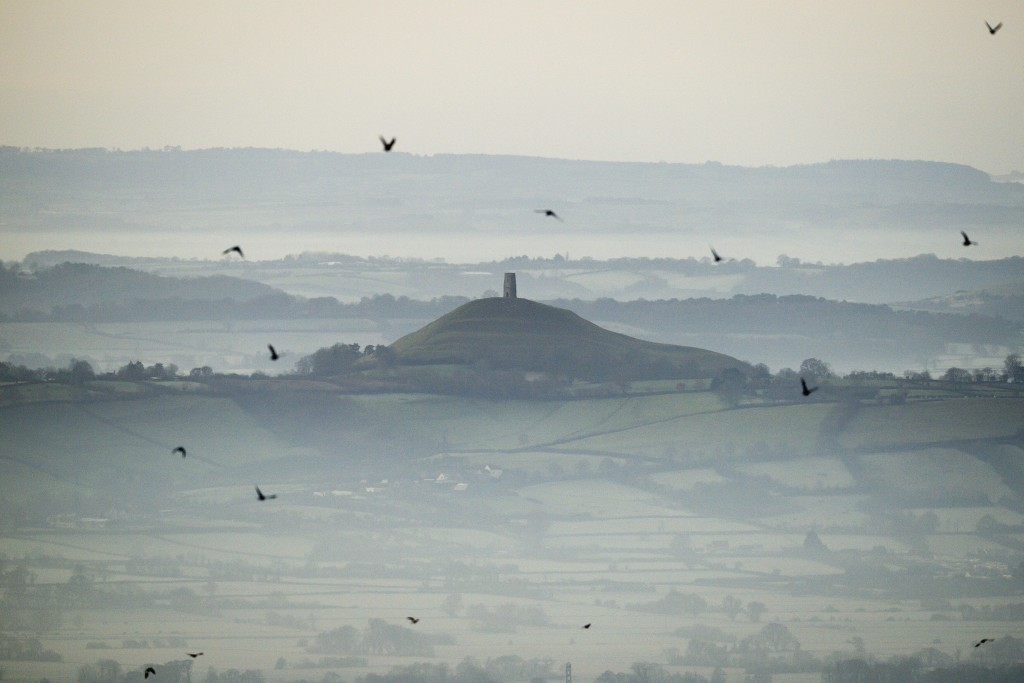 FILE - This Dec. 19, 2017 file photo shows Glastonbury Tor in Glastonbury, England, which is cared for by the National Trust. Britain's National Trust...