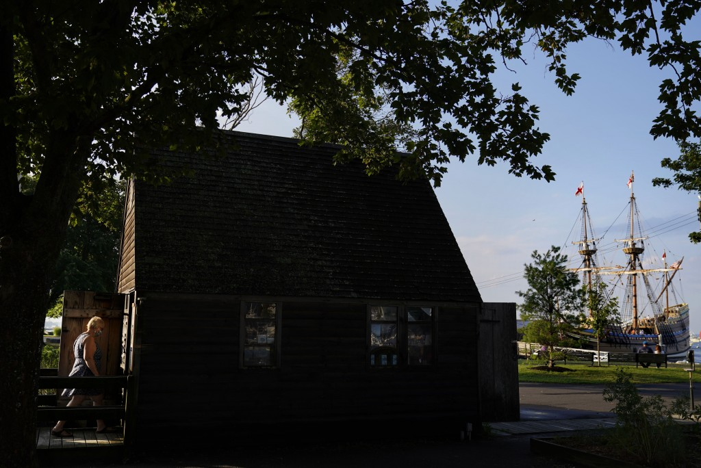 A visitor walks into a gift shop as the Mayflower II, a replica of the original Mayflower ship that brought the Pilgrims to America 400 year ago, is d...