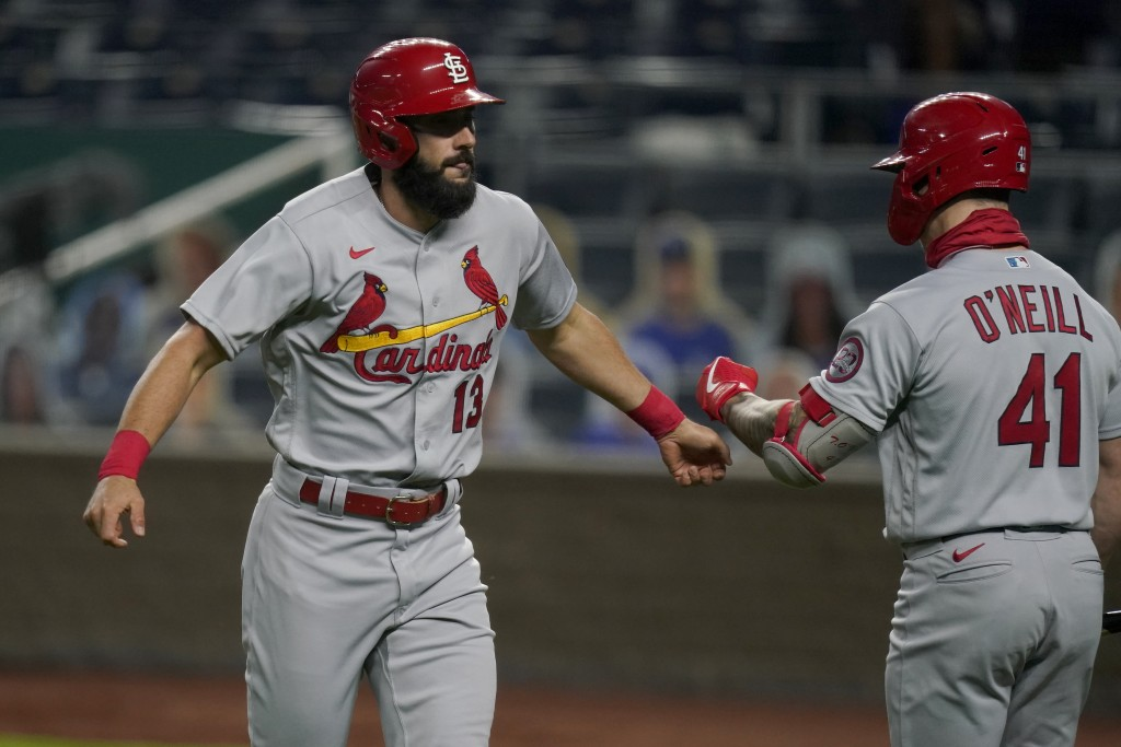 St. Louis Cardinals Matt Carpenter (13) is congratulated by teammate Tyler O'Neill (41) after his solo home run during the second inning of a baseball...