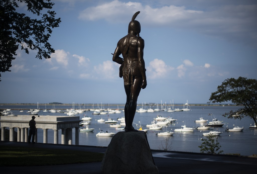 A statue of the Native Sachem (leader) Massasoit looks out over the traditional point of arrival of the Pilgrims on the Mayflower in 1620, in Plymouth...