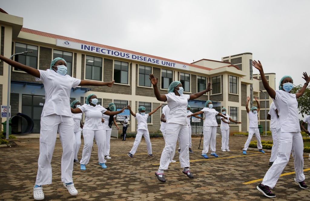 FILE - In this May 17, 2020, file photo, nurses who care for coronavirus patients take part in a Zumba dance-fitness class outside of the Kenyatta Uni...
