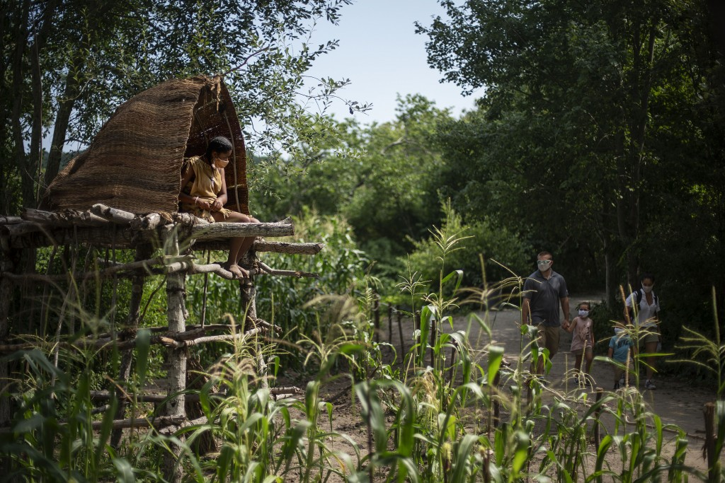 Alyssa Harris, a member of the Mashpee Wampanoags and a museum educator at Plimoth Plantation, a living history exhibit, sits in a corn watch tower as...