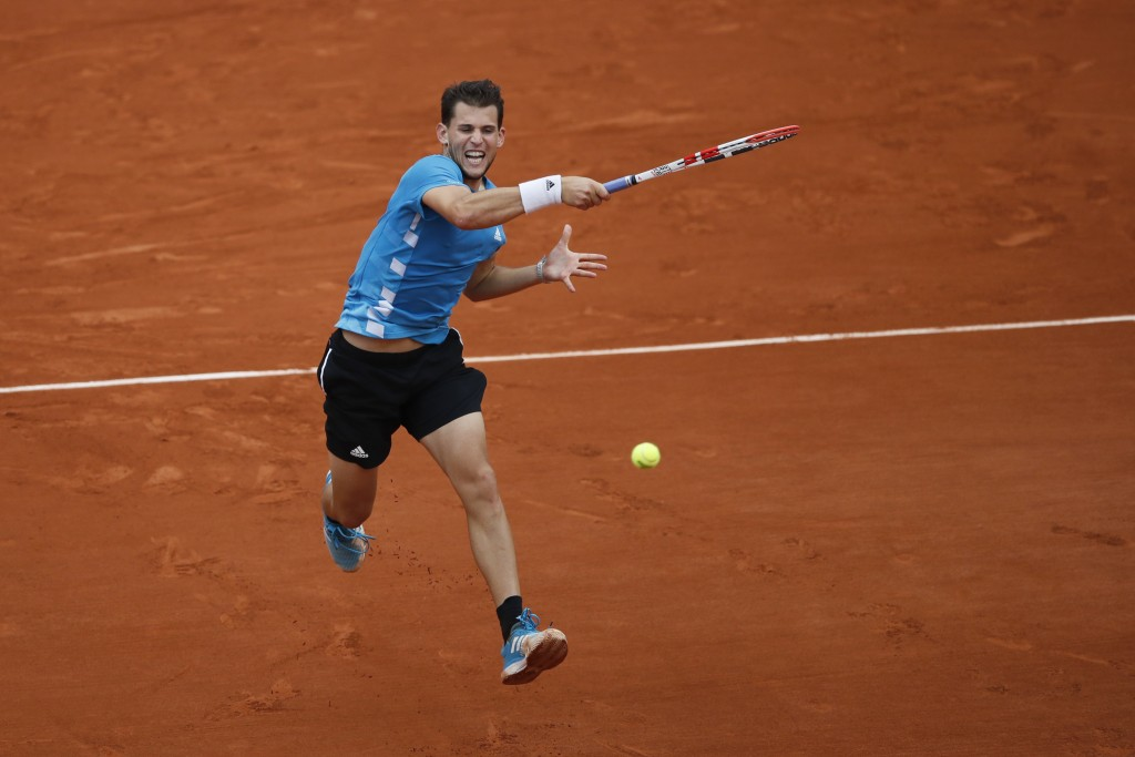FILE - In this Sunday, June 9, 2019, file photo, Austria's Dominic Thiem plays a shot against Spain's Rafael Nadal during the men's final match of the...
