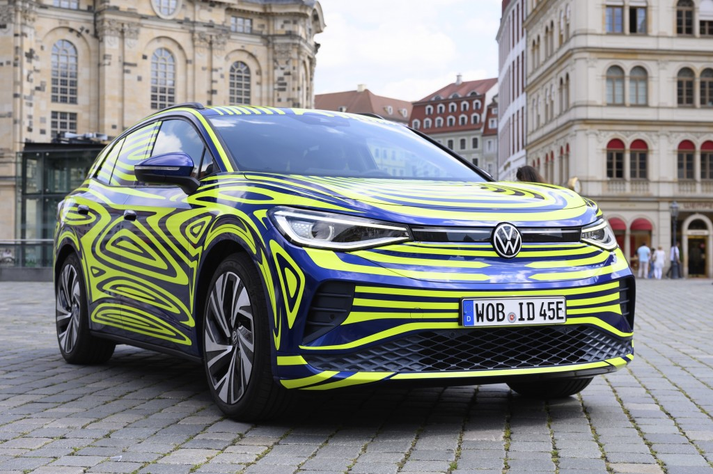 FILE - In this July 29, 2020 file photo, a VW ID.4 stands in front of the Frauenkirche on the occasion of a Volkswagen vehicle presentation on the Neu...