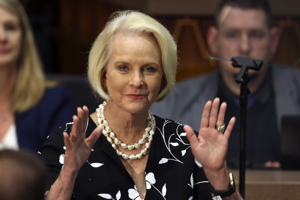 FILE - In this Jan. 13, 2020, file photo Cindy McCain, wife of former Arizona Sen. John McCain, waves to the crowd after being acknowledged by Arizona...