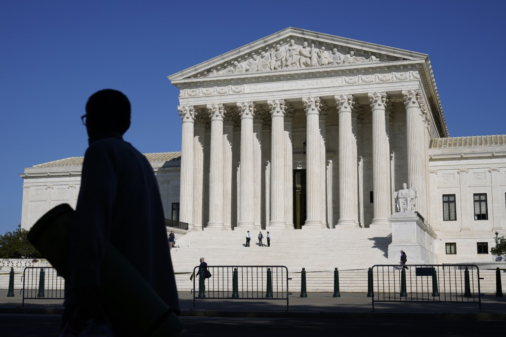 Officials stand on the Supreme Court steps on Capitol Hill in Washington, Tuesday, Sept. 22, 2020, as preparations take place for a private ceremony a...