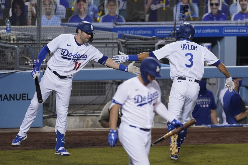 Los Angeles Dodgers' Chris Taylor, right, celebrates with A.J. Pollock after hitting a home run during the fourth inning of the team's baseball game a...