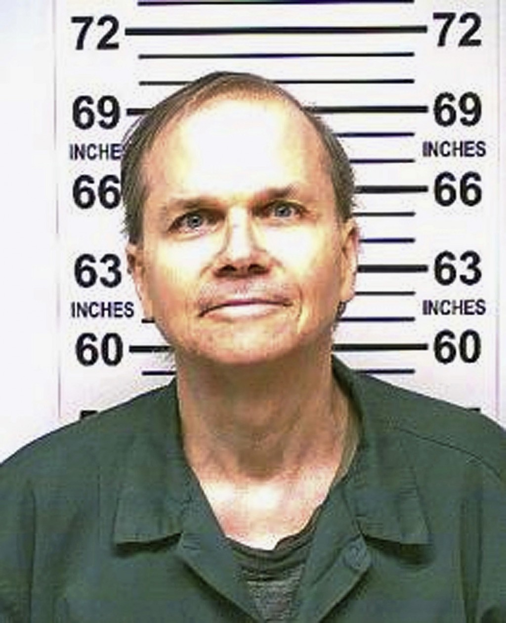 FILE -  This Jan. 31, 2018 photo, provided by the New York State Department of Corrections, shows Mark David Chapman, the man who killed John Lennon o...