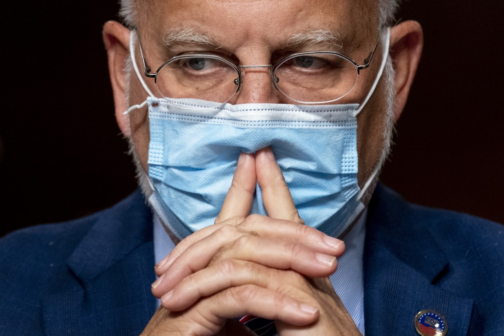 FILE - In this Sept. 16, 2020, file photo Centers for Disease Control and Prevention Director Dr. Robert Redfield appears at a Senate Appropriations s...