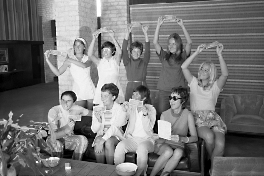 In this Sept. 23, 1970, photo provided the Houston Library, tennis players hold up $1 bills after signing a contract with World Tennis magazine publis...